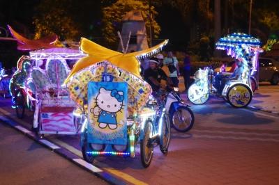 Trishaws at night
