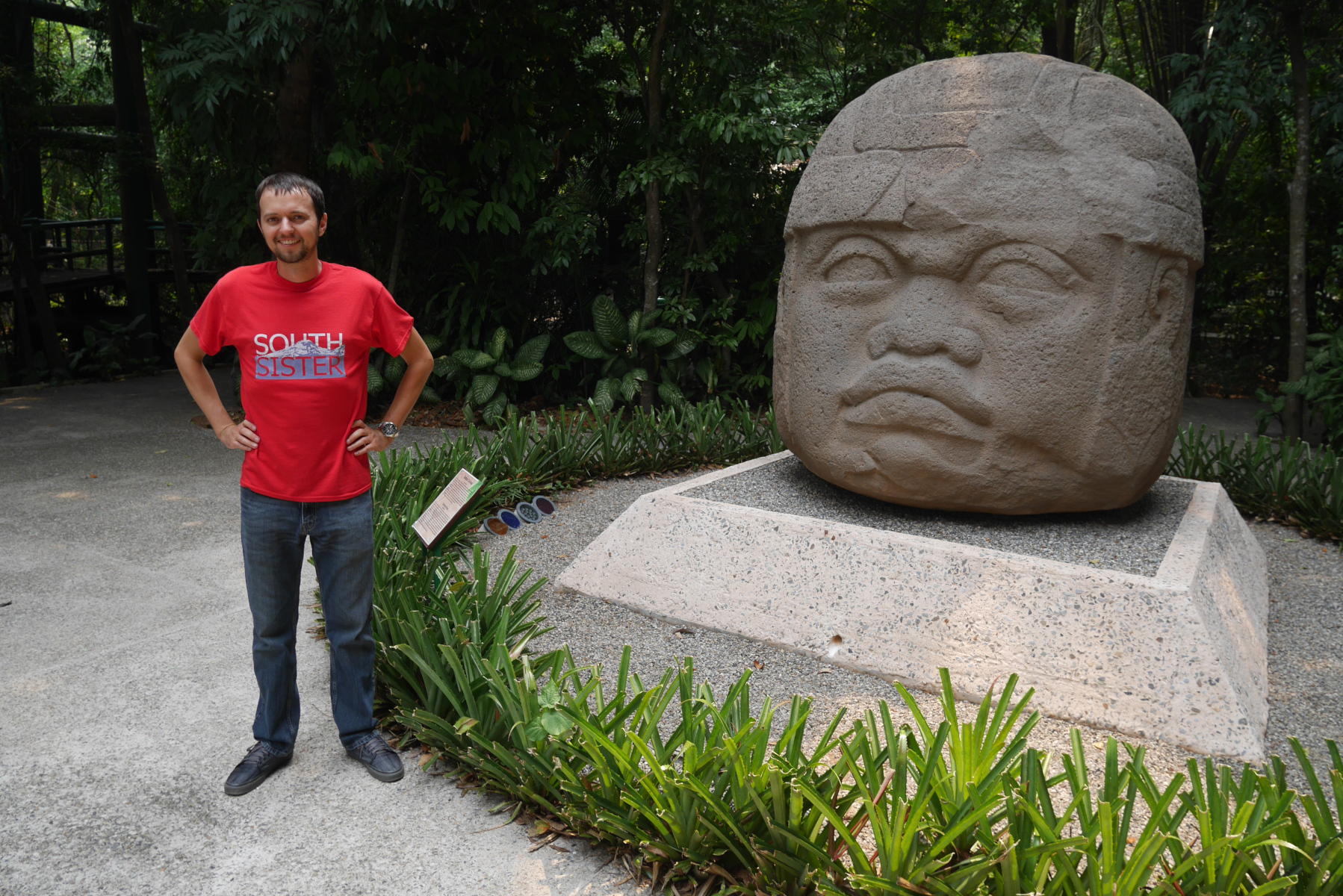 With Colossal Head No. 1 at Parque Museo La Venta, Villahermosa, Tabasco, southern Mexico.