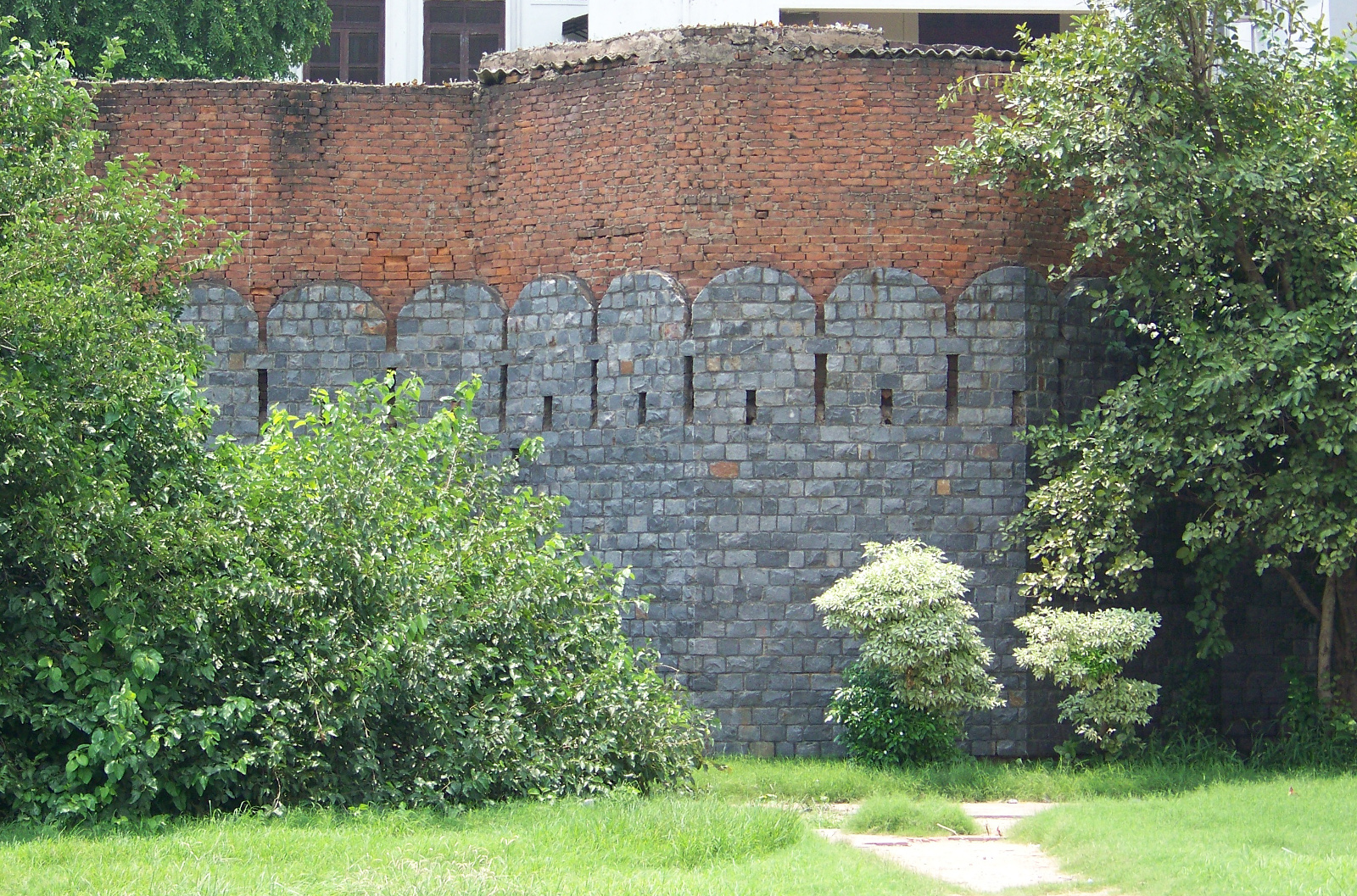 Remaining city wall serving as a retaining wall.