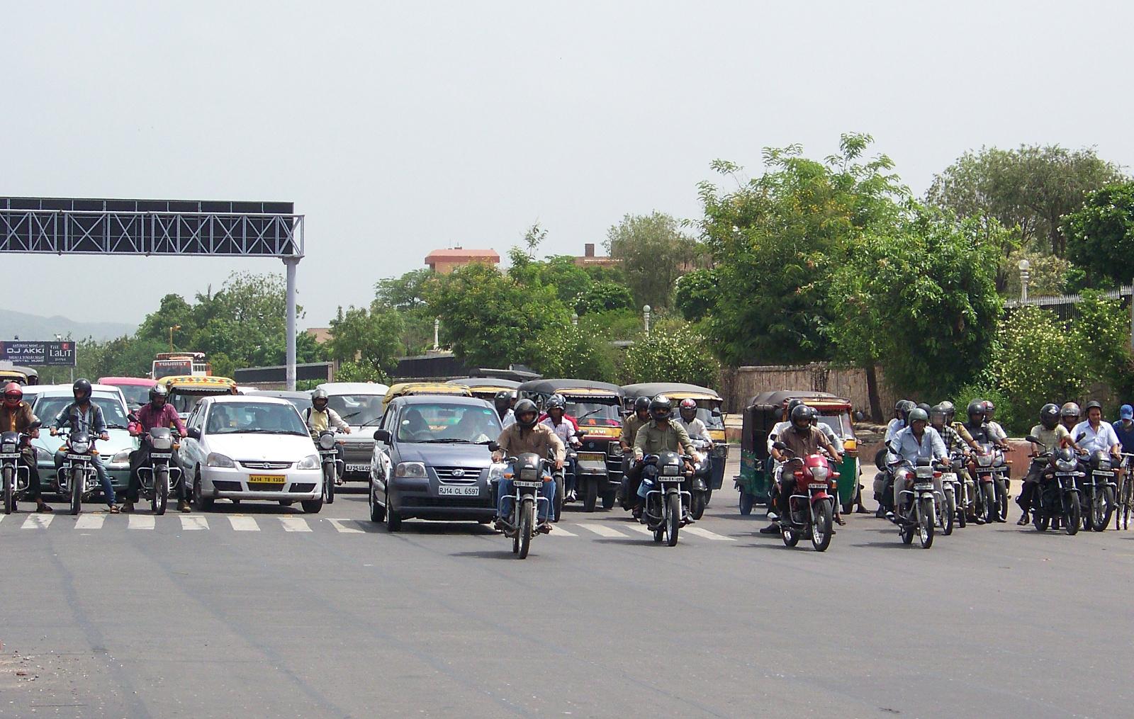 Motorcycles waiting at a light on Jawaharlal Nehru Marg, Jaipur.