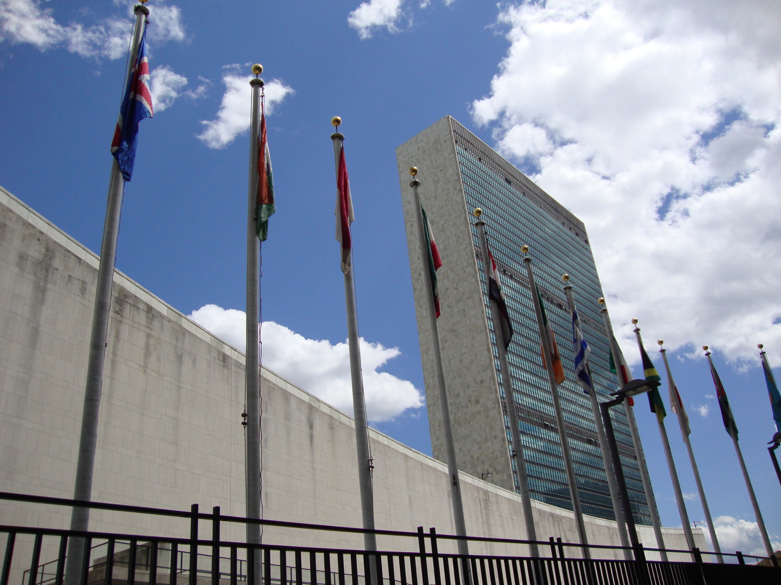 United Nations Secretariat, New York City, with flags of member states in the foreground.