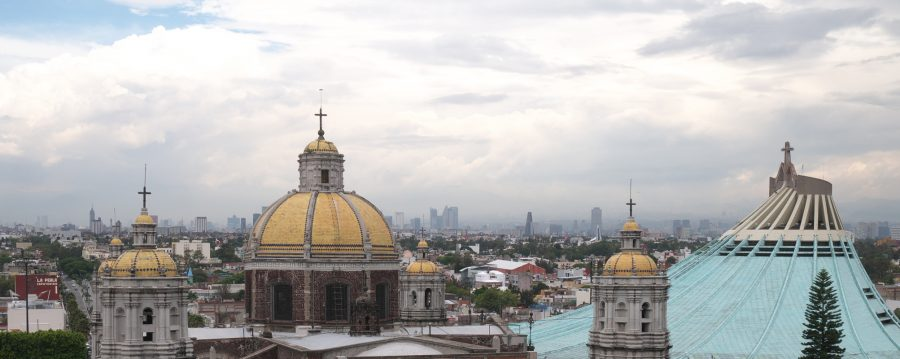 Villa de Guadalupe with Mexico City skyline in the distance.