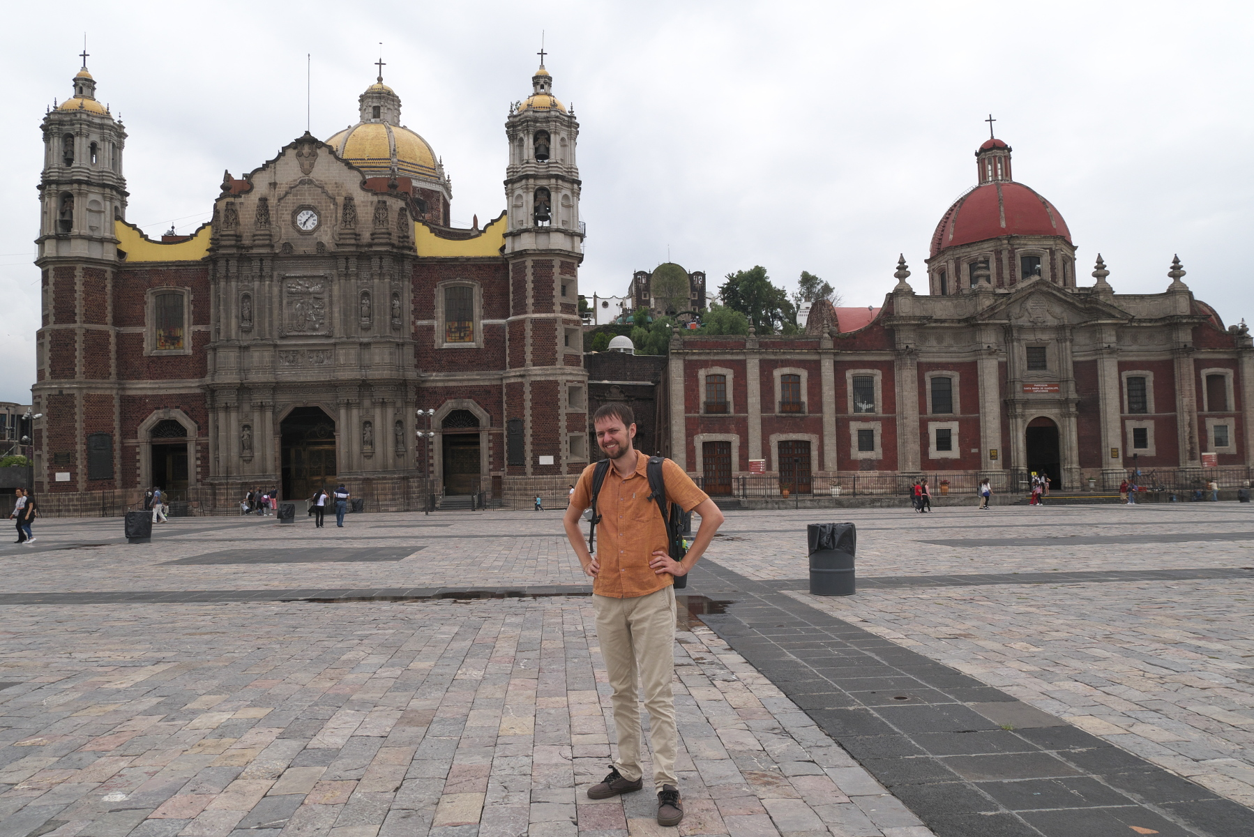 Your blogger in front of the old Basilica of Guadalupe (on the left with the yellow roof). (Photo by Verónica Trinidad Gallegos.)