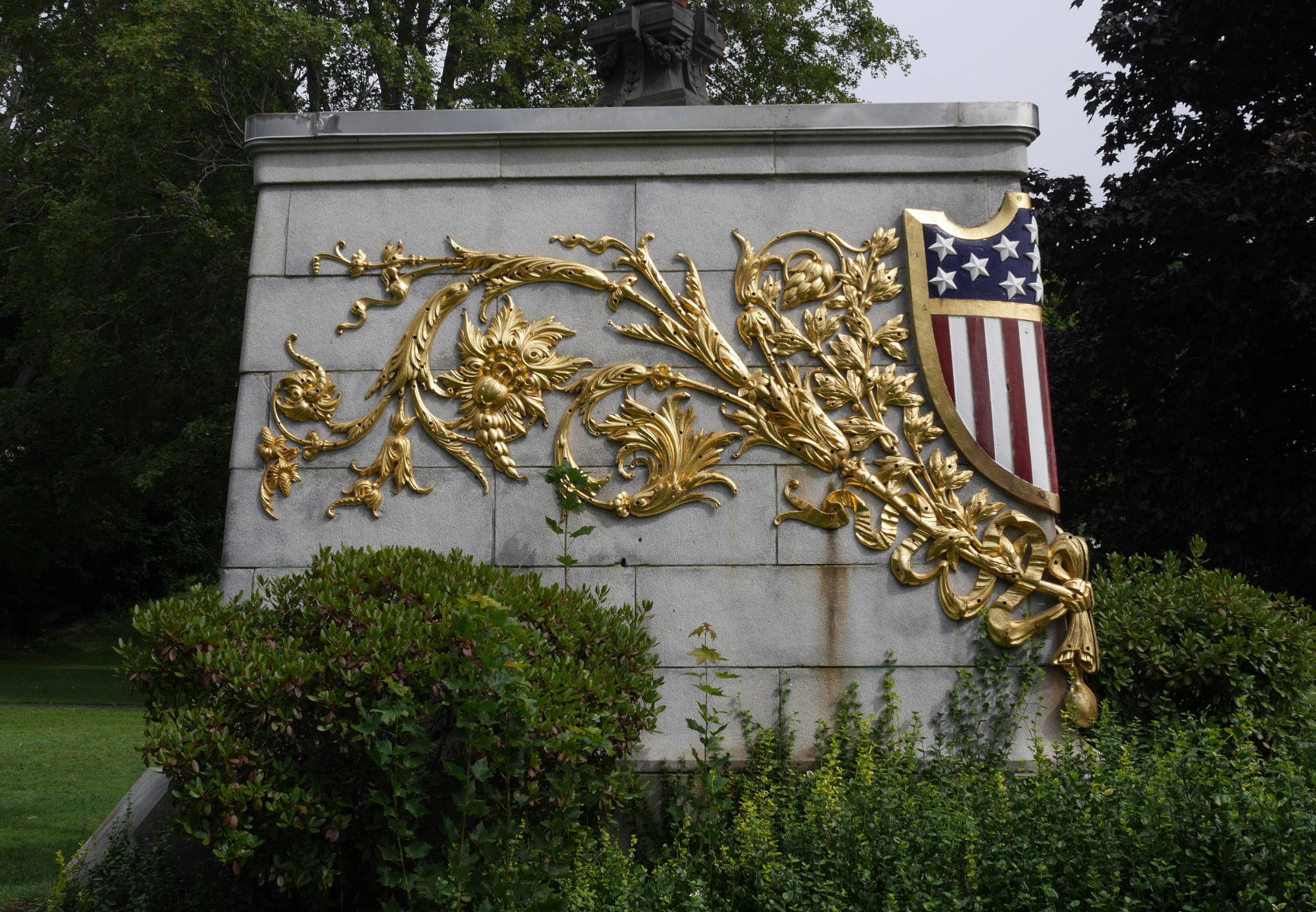 The gilded filigree that used to decorate the bow of the Maine, on a monument in Bangor.