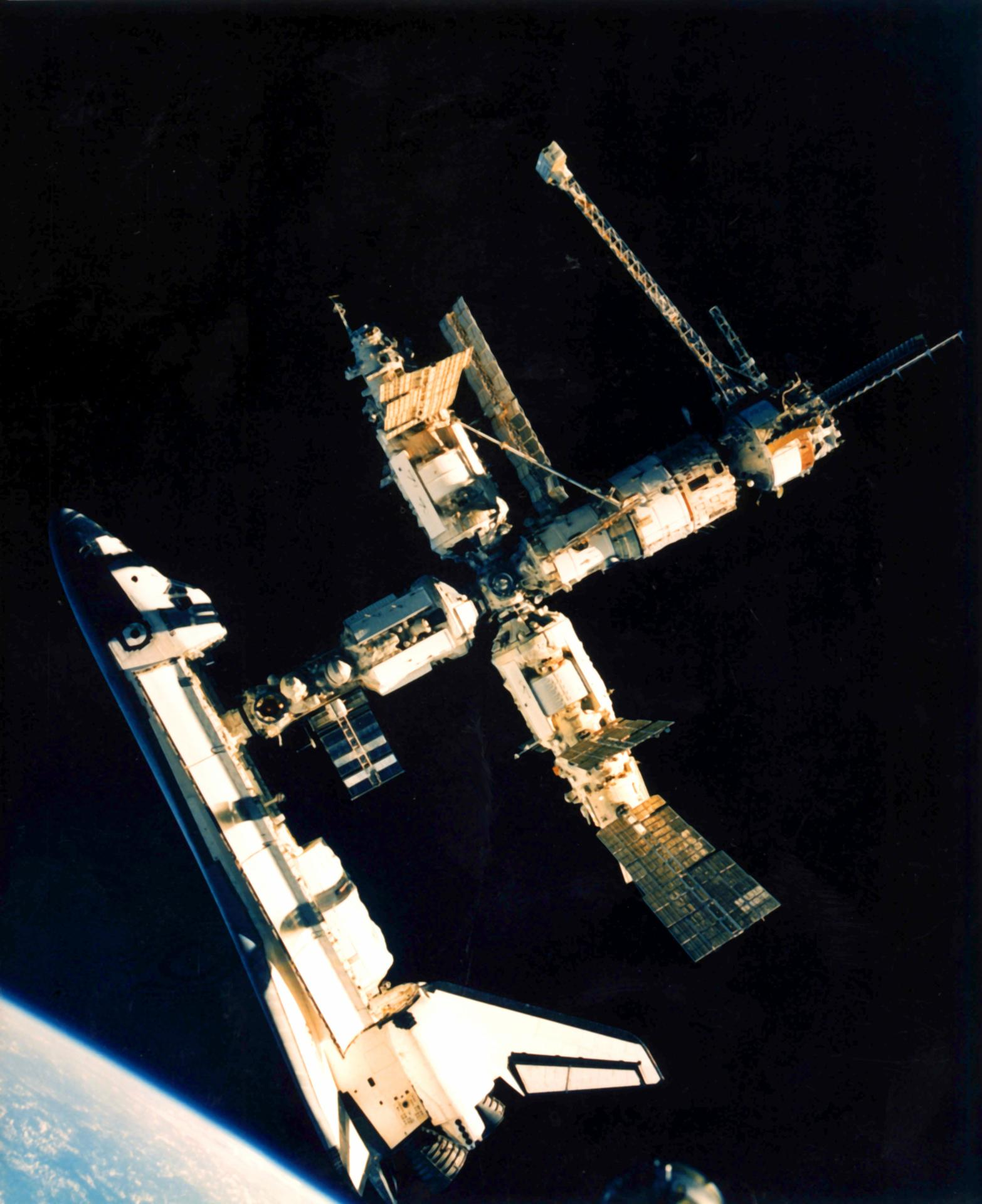 Space shuttle Atlantis docked with space station Mir