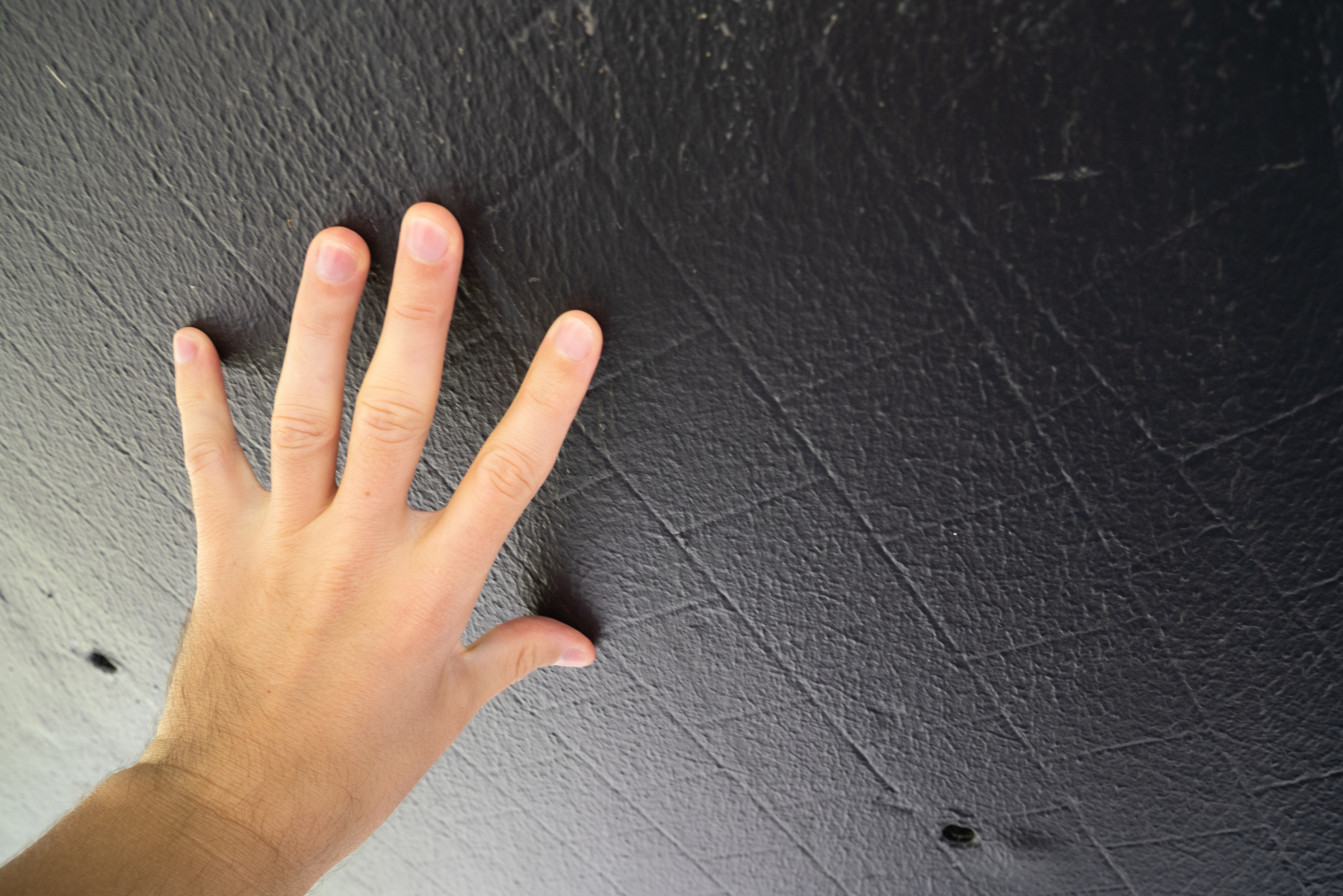 Your blogger's hand touching the underside of the wind tunnel model, with the individual tiles visible.