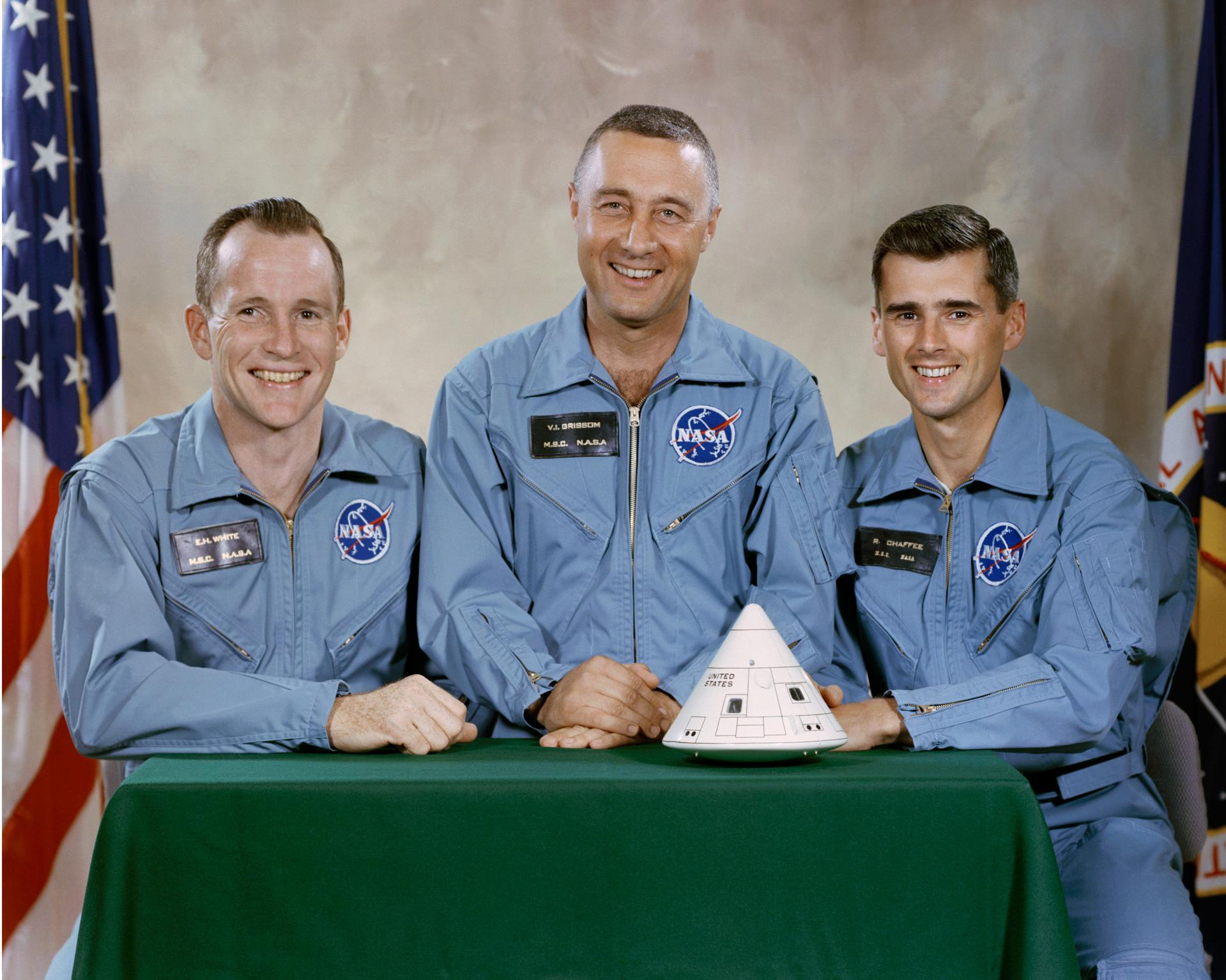 The prime crew of Apollo 1 posing with a model of their capsule (L-r): Ed White, Gus Grissom, and Roger Chaffee. (NASA photo)