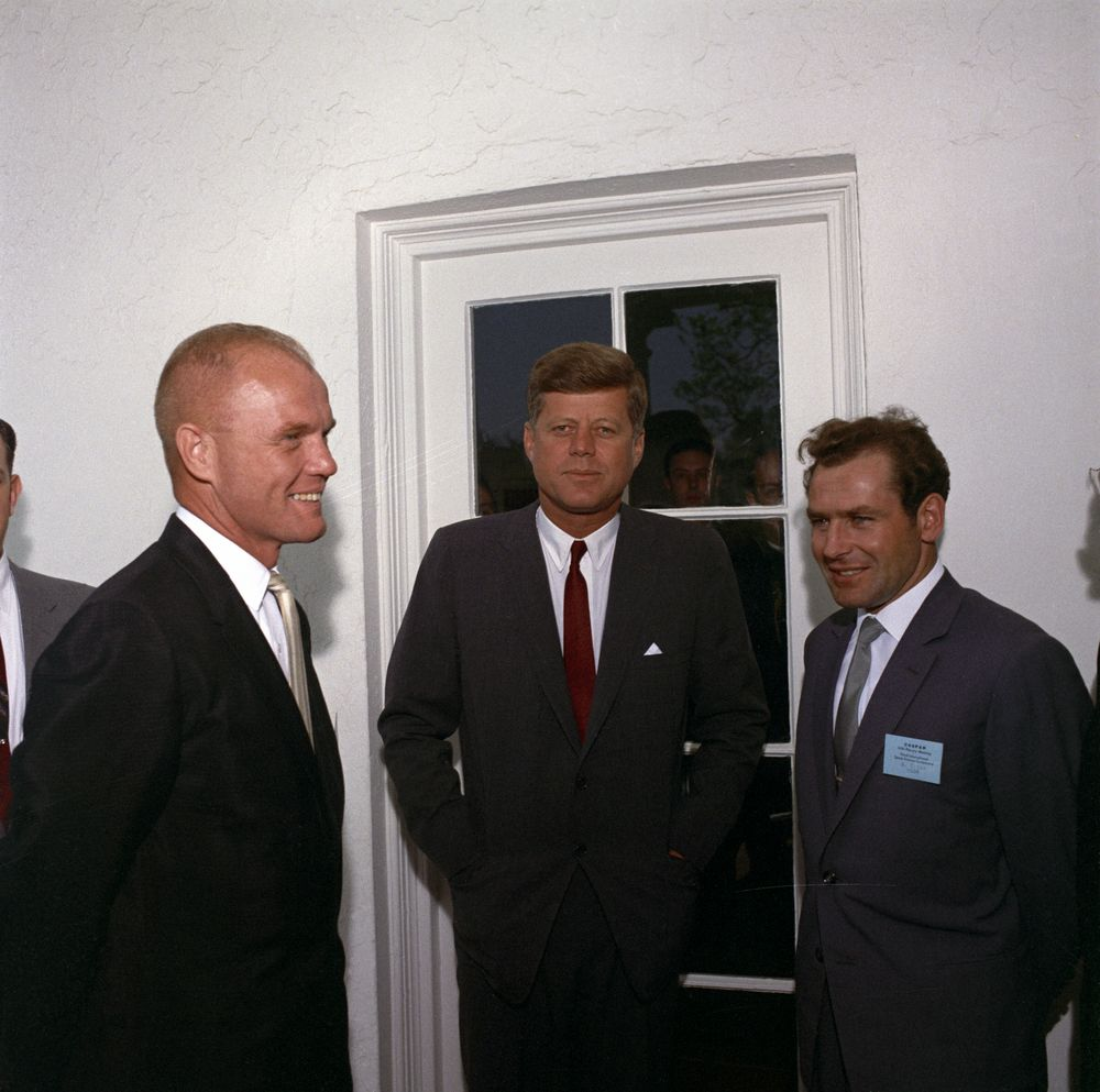 President Kennedy visits with American astronaut John Glenn (L) and Russian cosmonaut Gherman Titov (R) at the White House in 1962. At 25, Titov was the youngest person ever to fly into space. In 1998, John Glenn would become the oldest spacefarer, flying on the Space Shuttle at age 77. (Source: JFK Library)