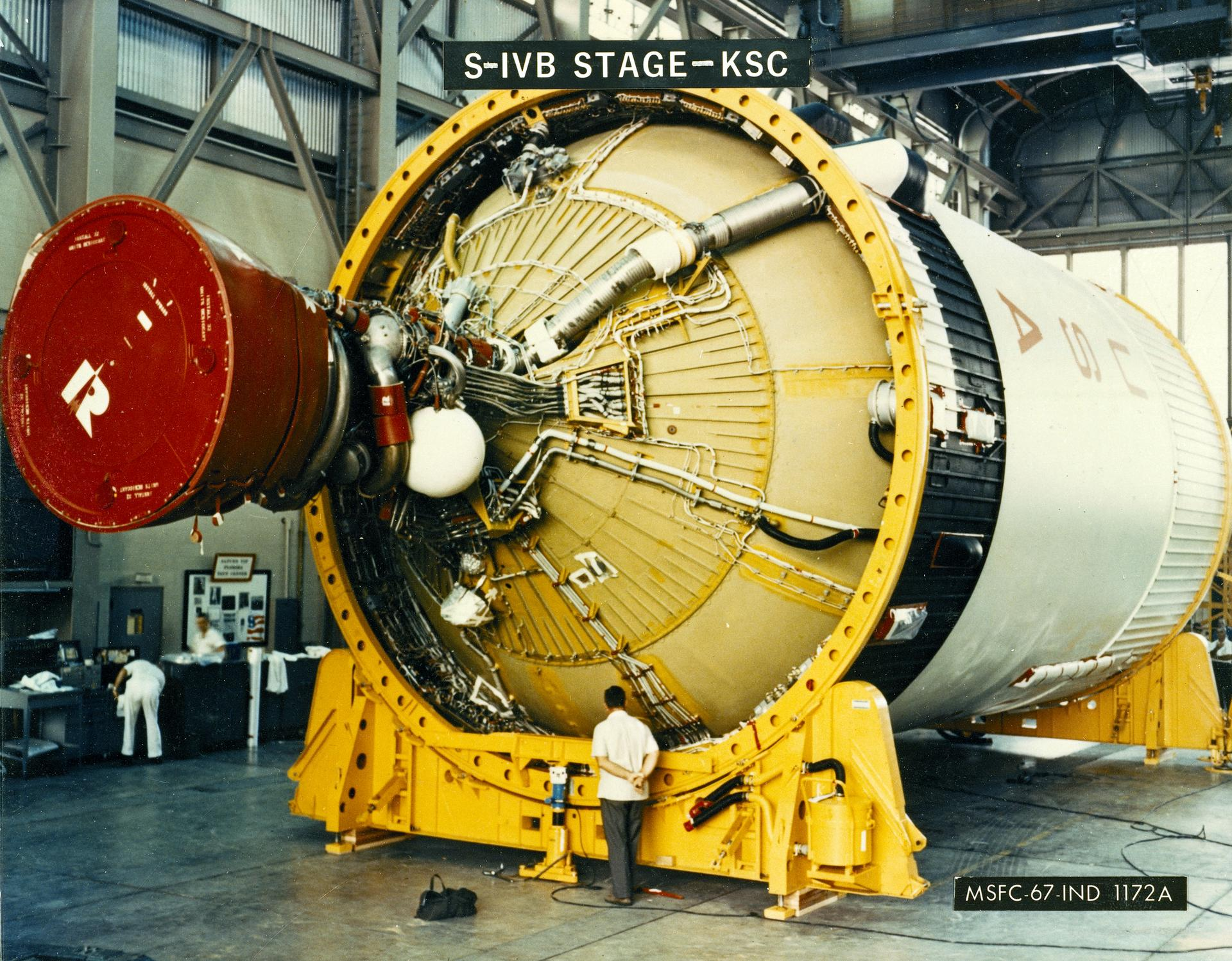 An S-IVB stage with a technician at Kennedy Space Center.